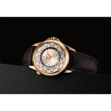 PATEK PHILIPPE - A fine and rare pink gold worldtime wristwatch with original certificate and fitted presentation box, 2008