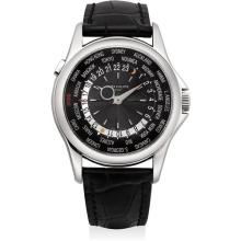 PATEK PHILIPPE - A fine and very rare platinum limited edition worldtime wristwatch with guilloché dial, original certificate and presentation box, produced exclusively for Ahmed Seddiqi & Sons of Dubai and made to commemorate its 60th Anniversary an