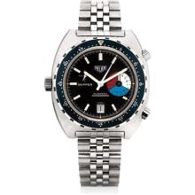 HEUER - A fine and rare stainless steel chronograph tonneau-shaped wristwatch with date and bracelet, Circa 1984