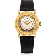 PATEK PHILIPPE - A very fine and rare yellow gold worldtime wristwatch, 1949