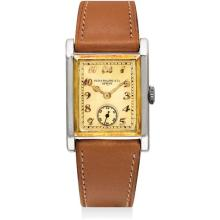 PATEK PHILIPPE - A rare and attractive two-colour gold rectangular wristwatch with champagne dial and Breguet numerals, 1928