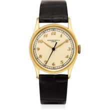 PATEK PHILIPPE - A rare yellow gold wristwatch with indirect sweep centre seconds and Breguet numerals, 1940