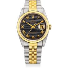 ROLEX - A fine yellow gold and stainless steel wristwatch with sweep centre seconds, date, ferrite hardstone dial and bracelet, Circa 1991