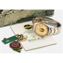 ROLEX - A stainless steel and yellow gold wristwatch with sweep centre seconds, date, bracelet, guarantee and fitted presentation box, Circa 1978