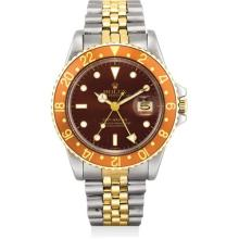 ROLEX - A fine yellow gold and stainless steel dual time wristwatch with sweep centre seconds, date and yellow gold and stainless steel bracelet, Circa 1981