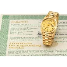 ROLEX - A fine and rare yellow gold calendar wristwatch with sweep centre seconds, champagne dial, bracelet and original guarantee, Circa 1972