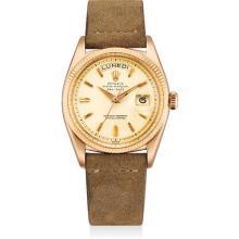 ROLEX - A fine and rare pink gold calendar wristwatch, Circa 1957
