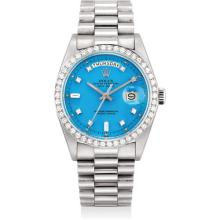 ROLEX - A very rare and attractive platinum and diamond-set calendar wristwatch with bracelet and turquoise colored lacquer