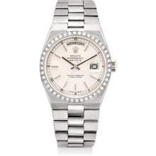 ROLEX - A fine and rare white gold and diamond-set calendar wristwatch with sweep centre seconds and bracelet, Circa 1984