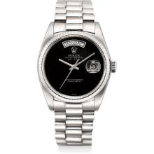 ROLEX - An extremely rare white gold calendar wristwatch with sweep centre seconds, onyx dial and bracelet, Circa 1982