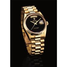 ROLEX - A fine and rare yellow gold calendar wristwatch witih sweep centre seconds, onyx dial and bracelet, Circa 1986