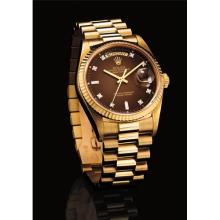 ROLEX - A very fine and rare yellow gold and diamond-set calendar wristwatch with sweep centre seconds, bracelet, dégradé dial, original guarantee and fitted presentation box, Circa 1987