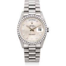 ROLEX - A fine and rare white gold and diamond-set calendar wristwatch with sweep centre seconds, bracelet and original guarantee, made for the Sultanate of Oman, Circa 1990