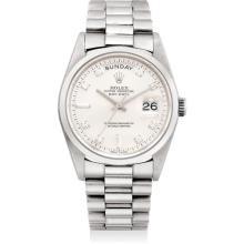 ROLEX - A fine and rare platinum and diamond-set calendar wristwatch with sweep centre seconds and bracelet, Circa 1997