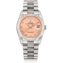 ROLEX - A fine and rare white gold calendar wristwatch with salmon dial, bracelet and original guarantee, Circa 1993