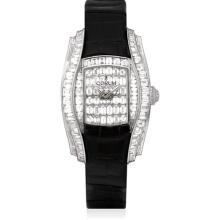 CORUM - A fine and rare white gold and diamond-set tonneau-shaped wristwatch, Circa 2007