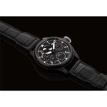 IWC - A fine black ceramic perpetual calendar wristwatch with moon phases, power reserve and digital year display, Circa 2012