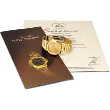 PATEK PHILIPPE - A fine and rare yellow gold bracelet watch with sweep centre seconds, date and original certificate, 1983