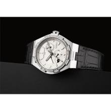 VACHERON CONSTANTIN - A fine white gold and diamond-set dual time wristwatch with sweep centre seconds, power reserve, date and day and night indicator, Circa 2010