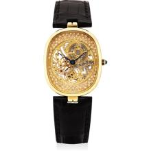 PATEK PHILIPPE - A fine and rare yellow gold and diamond-set skeletonised cushion-shaped wristwwatch, 2001