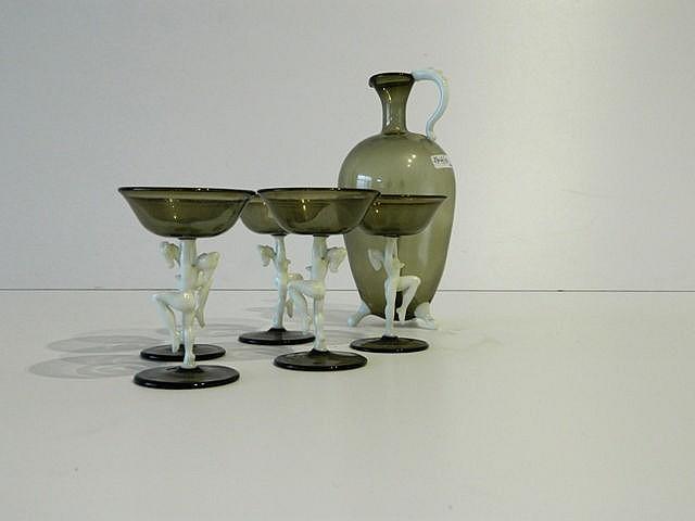 Suite d'un carafon ovoïde et de cinq verres à pied ornés de danseuses, mi-X