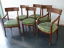Suite de deux fauteuils et quatre chaises Empire garnis de tissu vert orné