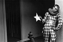 Duane Michals: Harlequin, c. 1985, vintage gelatin silver print, signed and numbered out of 100 in pencil on verso