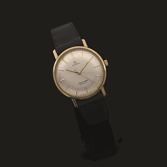 OMEGA, modèle Seamaster de ville Montre bracelet d''homme, la montre de forme ronde en métal doré, cadran satiné, index bâtonnets, tr..