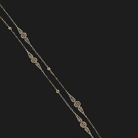Sautoir à mailles filigranées en or jaune.Longueur : 74 cm.