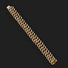 Bracelet en or jaune 18k, 750‰ lisse et torsadé à maillons gourmette entrelacés.Longueur : 16 cm