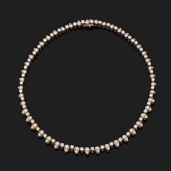 O.J. PERRIN, Paris.Collier rivière en or jaune 18k, 750‰ composé de maillons en forme de gouttes ornés de diamants taille brillant.