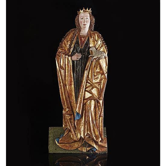 Sainte Agnès en bois de résineux sculpté enapplique, polychromé et doré. Debout, la tête