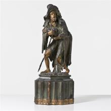 Gueux portant un enfant en tilleul sculpté etpolychromé