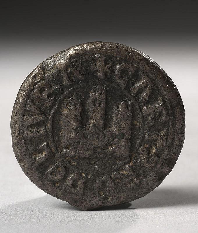Poids en bronze d'un quart de livre de la ville de Toulouse. Avers : inscription en onciales CARTARO DE LIVRA (1/4 de livre) avec un c
