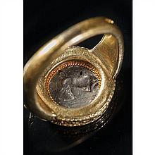 Bague en or sertie d'une pièce en argent