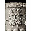 Vasque en pierre d'Istrie sculptée à décor demasques d'homme barbu et de grotesques