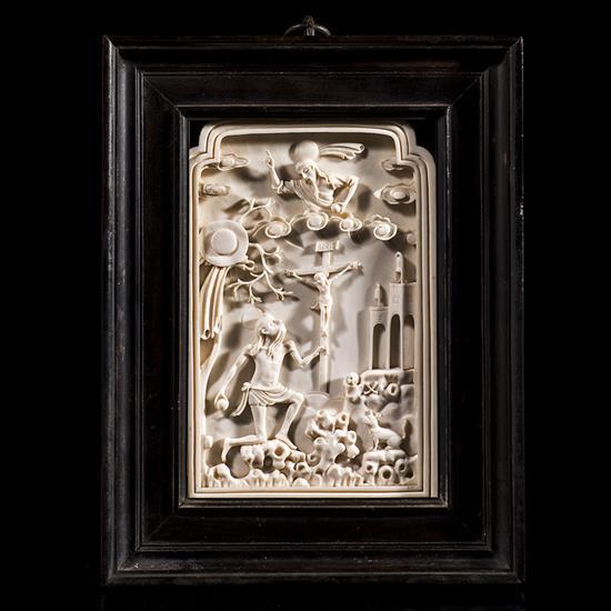 Plaque en ivoire profondément sculpté représentant saint Jérôme au désert, de forme rectangulaire avec la partie supérieure à ressau...