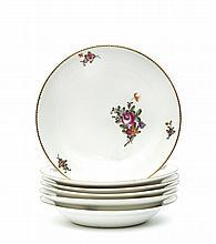 Limoges Suite de six assiettes à potage à décor polychrome de bouquets de fleurs décentrés et filet dentelé or sur le bord. Marq...