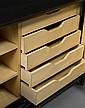 Jean PASCAUD (1903-1993) Commode en bois laqué noir ouvrant par deux portes à décor géométrique de losanges reposant sur un piètement d