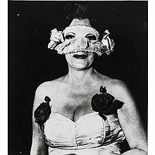 Diane Arbus (1923-1971)Lady at a masqued ball, 1962