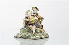 Marseille Groupe à deux figures représentant une jeune fille écoutant un jeune garçon jouer de la cornemuse assis contre un tronc d'ar