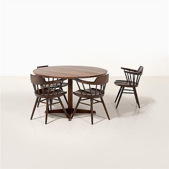 George Nakashima (1905-1990)Suite de quatre fauteuils Captain et table