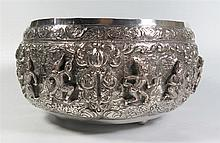 A Large Asian Silver Bowl with repoussé decorated scenes of dancers, engrav