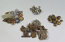 A Collection of Military Badges and Buttons