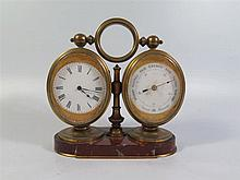 A Nineteenth Century Three Dial Clock incorporating aneroid barometer and t