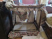 An Eighteenth Century Mahogany Doll's Tester Bed Frame with mattress and bo