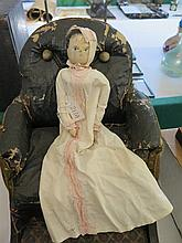 An Early Wooden Peg Doll with painted face and jointed limbs (losses)