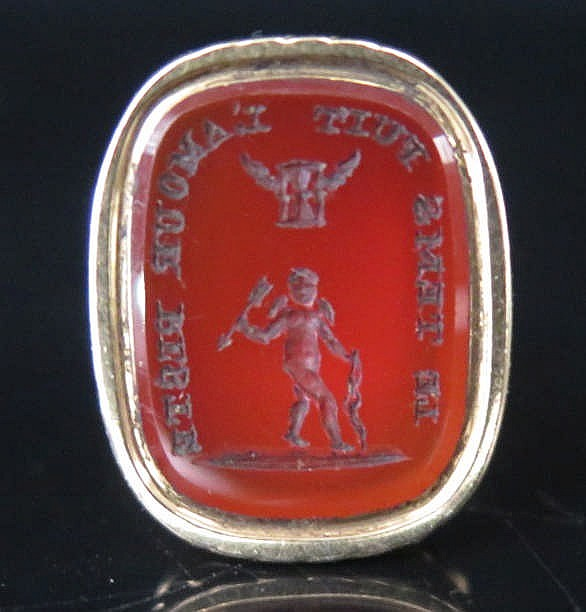 A Nineteenth Century French Seal mounted with cornelian matrix bearing a fi