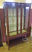 An Edwardian Mahogany and Marquetry Serpentine Glazed Display Cabinet