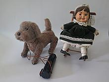 A Battery Operated Remote Controlled Automaton Dog and doll in rocking chai